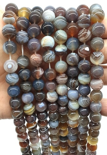 Perle di agata Bostwana 10 mm su un filo di 40 cm