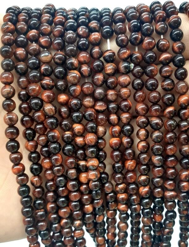 Perles Oeil de Taureau 4mm sur fil 40cm